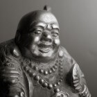 Gelukssymbolen: de Lachende en de Huilende Boeddha